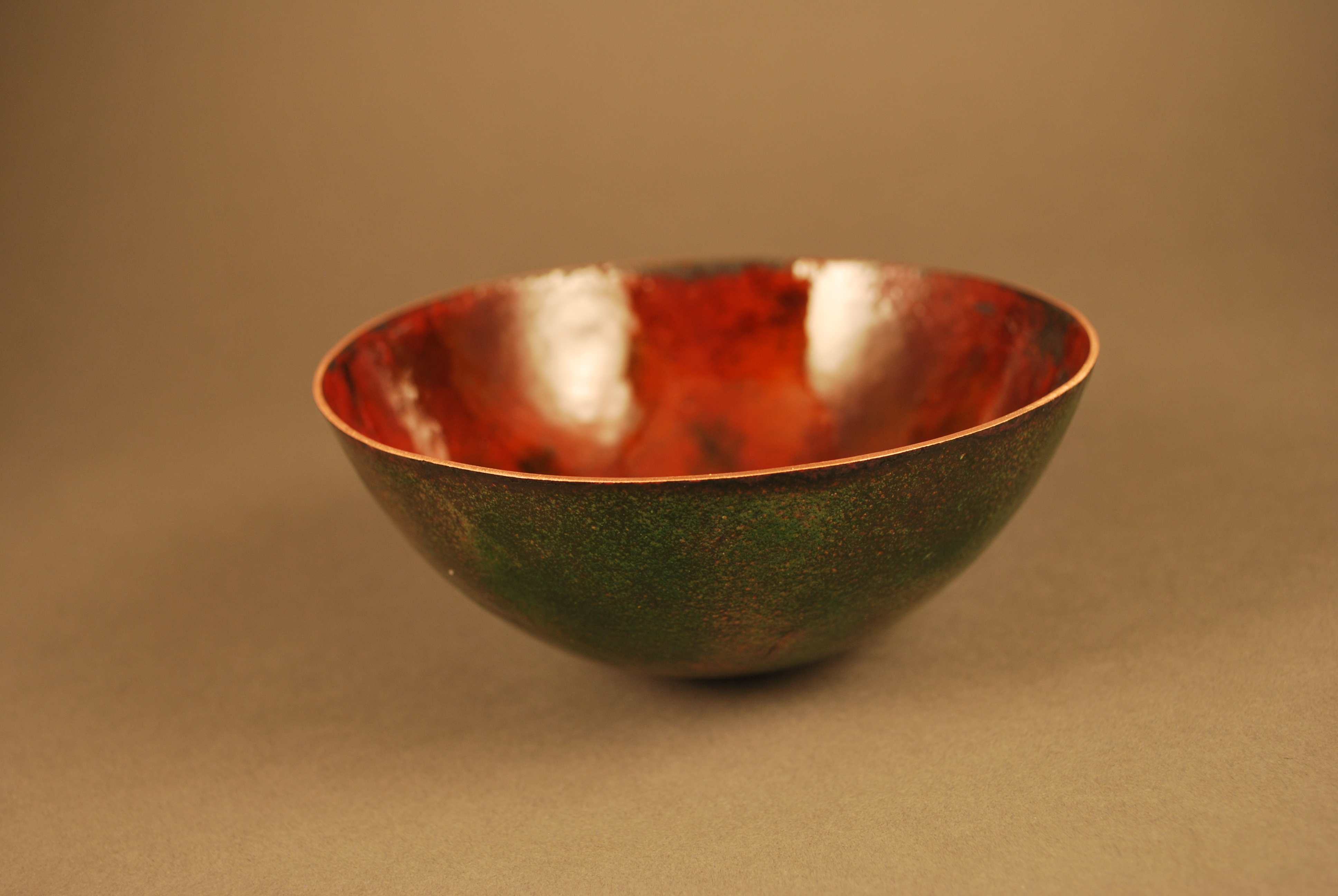 Copper bowl with avocado color patina on outside